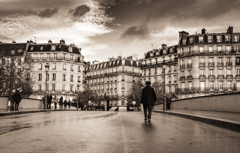 man walking down the street in Paris.