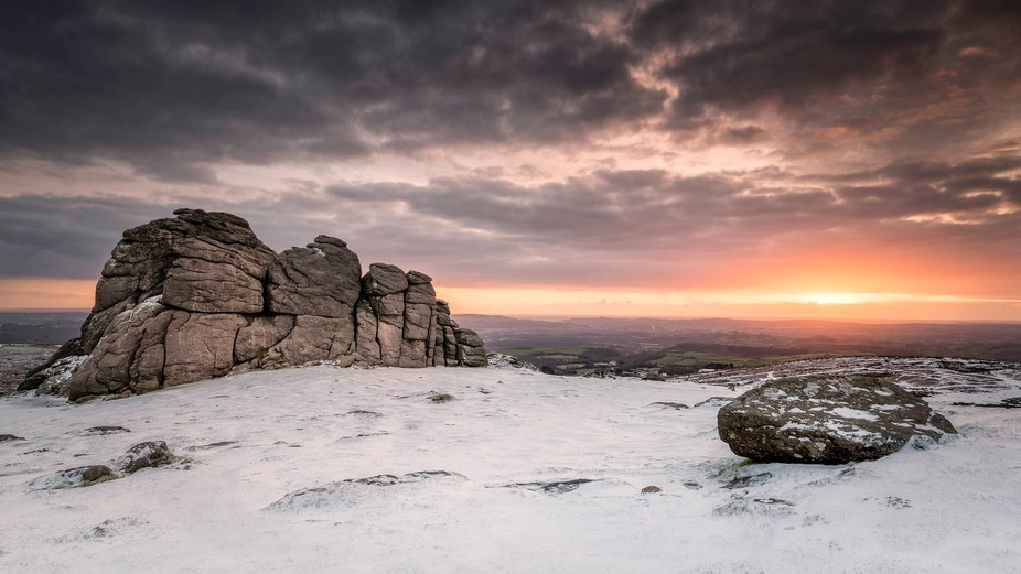 Snow at sunrise on Haytor, Dartmoor.