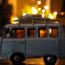 Bokeh effect with a camper van and some Christmas lights .