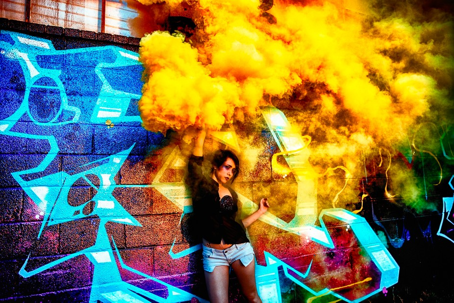 This picture had some HDR toning done to it in post production to create such wild and deep looking colors. The depth created within the graffiti as well as the depth in the smoke makes this such a visually appealing image.