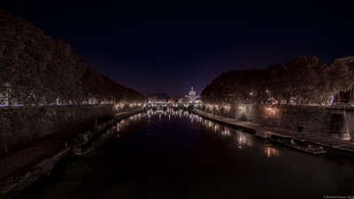 A distant St. Peter Basilica at night