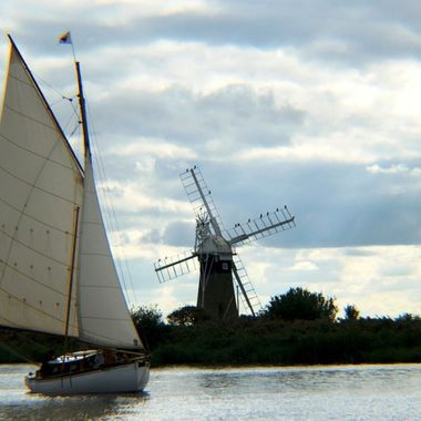 Yacht sailing past St Benet's Windmill
