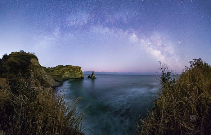 Milky Way Arch over Candle Rock bay by DamonBay - Capture The Milky Way Photo Contest