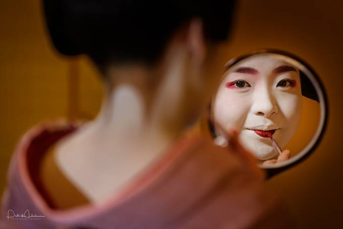 Young maiko fixing her make-up by Patosan - Anything People Photo Contest