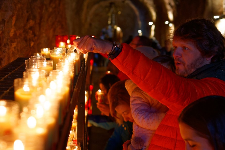 Candles at the entrance of the Virgin of Covadonga hermitage, colloquially called La Santina. Ast...
