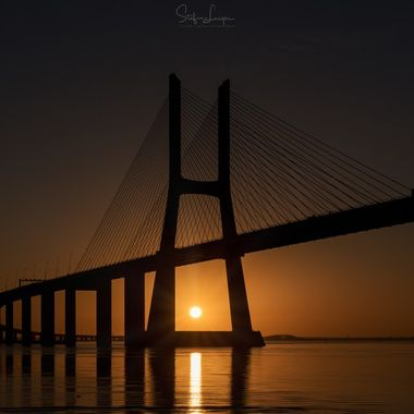 Sunrise through the Vasco da Gama bridge in Lisboa