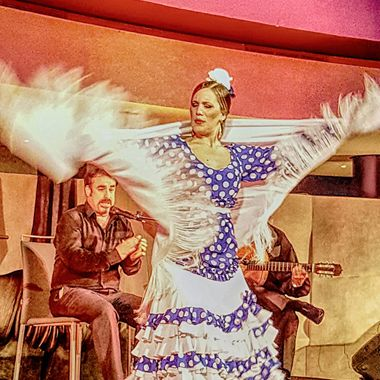 I took this photo when me and my wife went to Spain for a conference at Seville in November, 2017. After the conference, the organizers organized a cocktail where there was Flamenco dancing. This was one of the photos I took that evening.