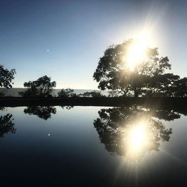 Beautiful sunrise over a swimming pool.