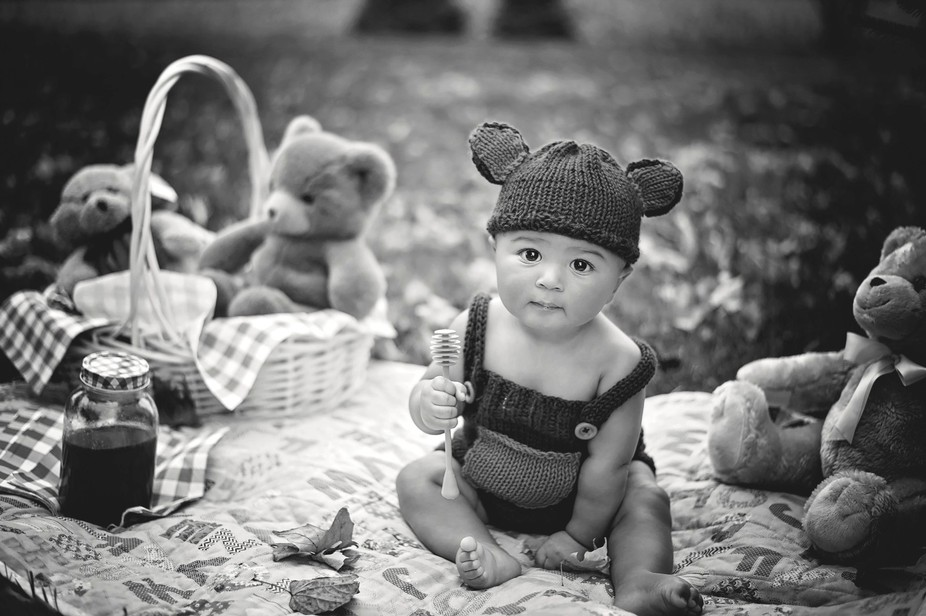 Having a picnic with his favorite teddy bears for his 6 month milestone.