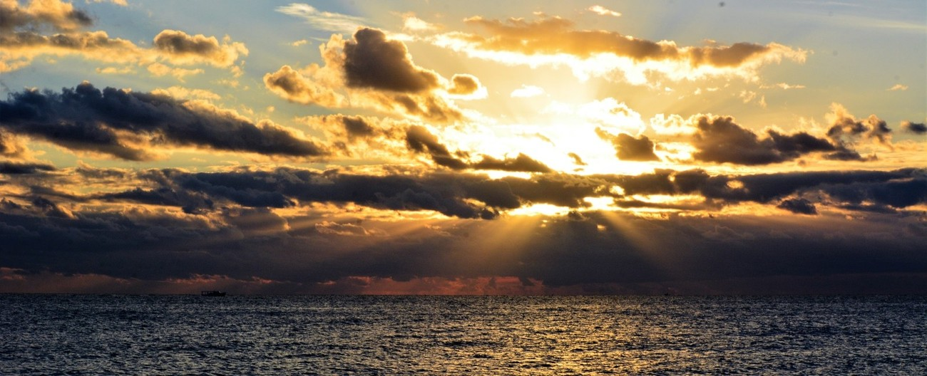 I like going to the beach early in the morning to get a glimpse of the Sunrise. Is not always I can get a good sunrise, but even then I can get the majestic look of the Sunrays.