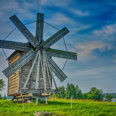 I took this photo when we were on a boat tour, on the Volga River, in the year 2013. The Kizhi Island is an open air museum where it has ancient wooden buildings like this windmill.