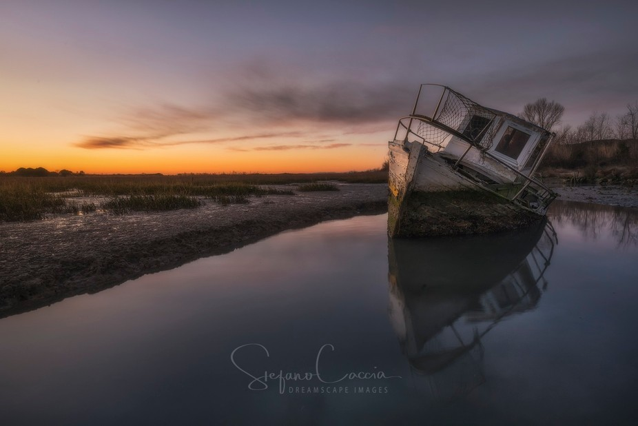 Wreck boat at the tagliamento river delya on sunset