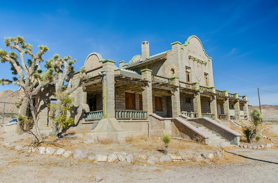 Rhyolite, Nevada grew quickly beginning in 1905 as a booming gold mining town but declined almost...