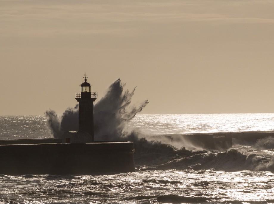 Small lighthouse, big wave