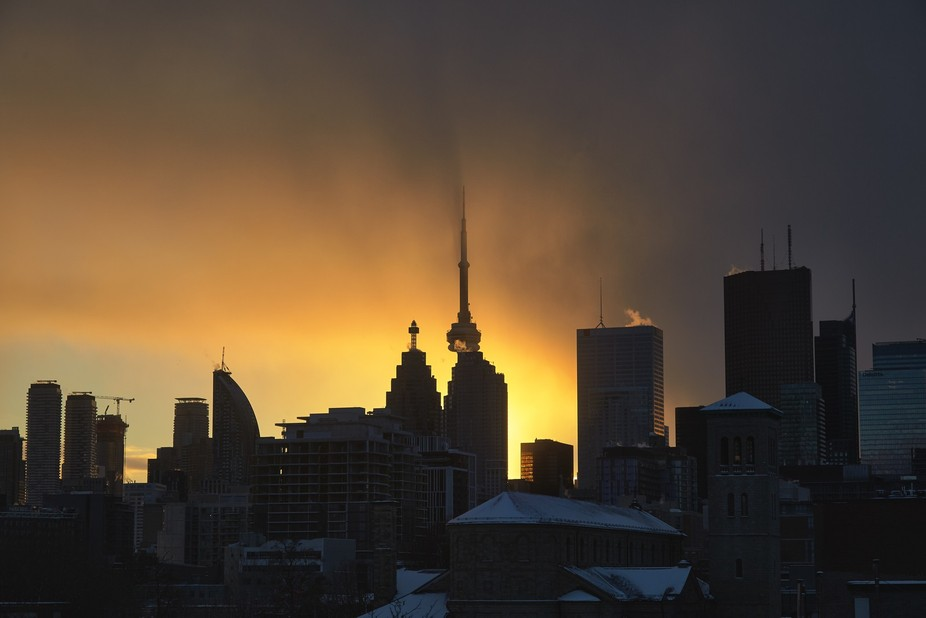 Snow Squall moving across downtown Toronto at Sunset.
