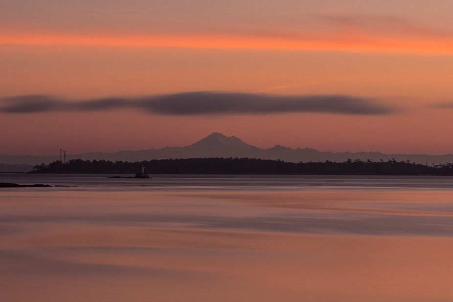 From Vancouver island looking over Juan de Fuca strait, with Chatham island, and Mt Baker in the ...