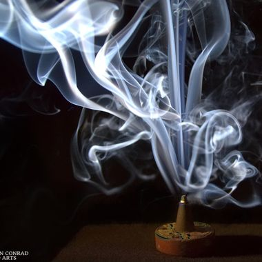 Stacked Composite of Incense Smoke Trail Caught With Speedlight