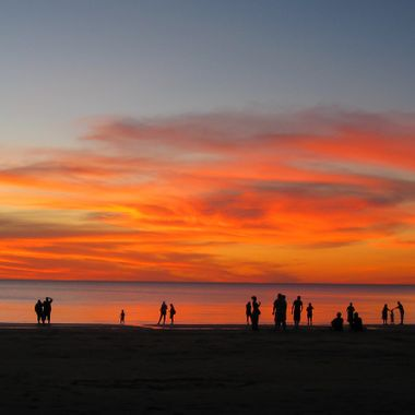 After the Wet season ends in Darwin Australia  the Mindle beach markets restart. One of the favourite things to do is buy some fish and chips and watch the Sun set .