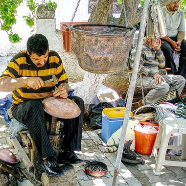 This photo was taken at the Büyükkonuk Eco Festival, in the year 2011. The man from the village was demonstrating how they used to make pots and pans from copper.