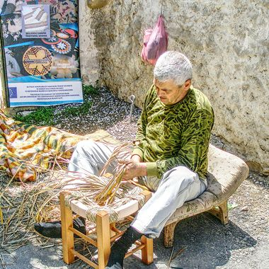 This photo was taken at the Büyükkonuk Eco Festival, in the year 2011. The man from the village was demonstrating how the villagers used to make chairs from wood and straw.