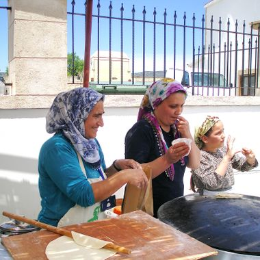 This photo was taken at the Büyükkonuk Eco Festival, in the year 2011. The women from the village were cooking Cypriot food and selling them to people at the festival.