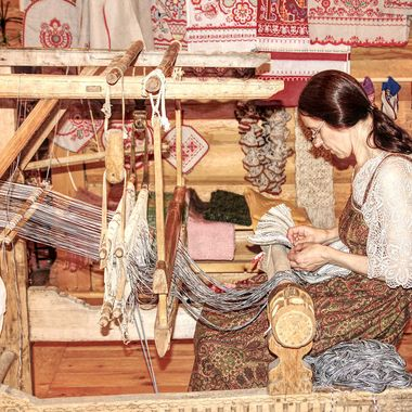 I took this photo when me and my wife went on boat ride on the Volga River in Russia. On the way to Moscow, we stopped at the beautiful village of Mandrogi. As we were walking round the village we came to a building where there was this woman weaving cloth. So, this was one of the photos I took that day.