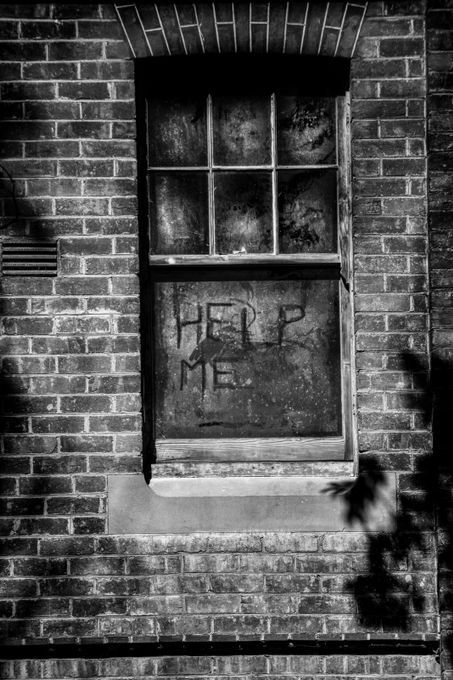 Second story window of a disused Mental Asylum.