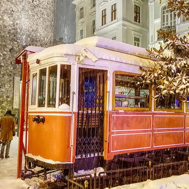 I took this photo when my wife and I were in Istanbul, in the year 2015. We were walking in the snow in Istanbul and we came to a large historical tower. Next to the tower there was this train displayed for the public to see. So, this was one of the photos that I took that day.