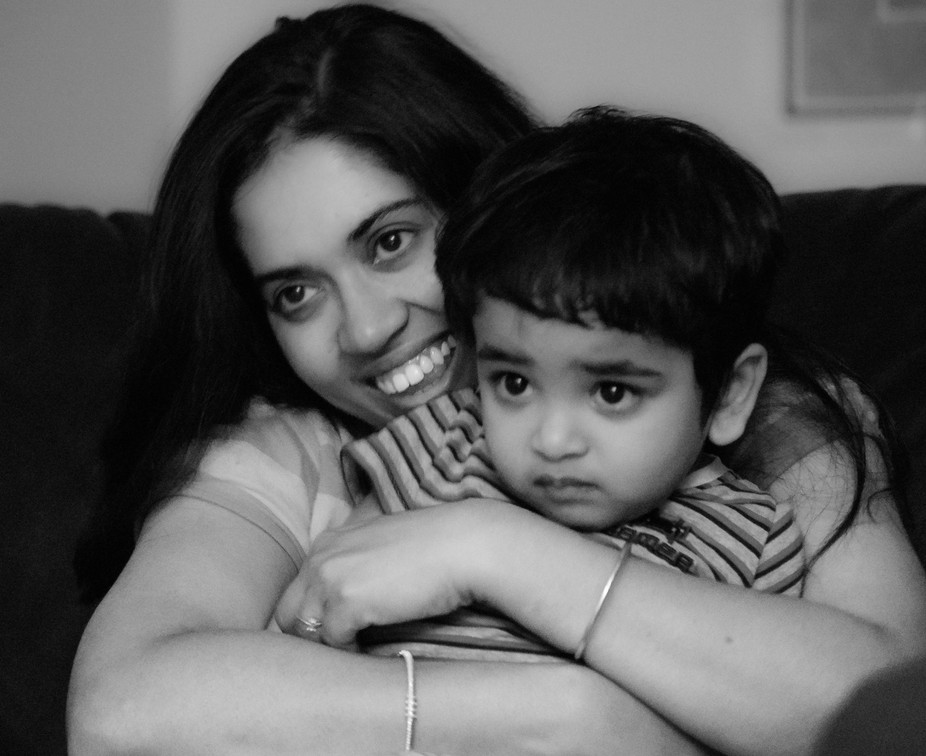 The picture shows a moment shared between a mother and his son. A precious moment in my family