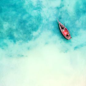 boat and ship in beautiful turquoise ocean, top view