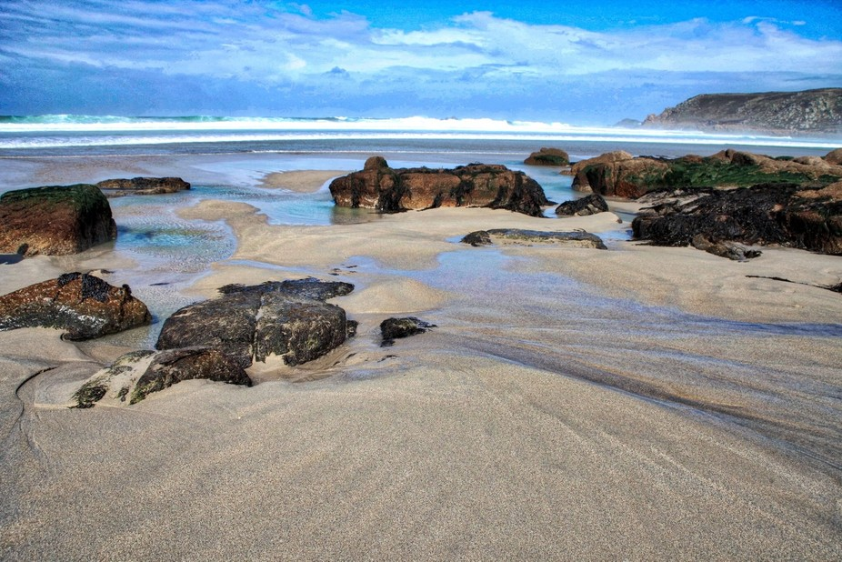 I just love any beach when the outgoing tide has washed the sand and the rocks.