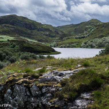 High up in the highlands of Scotland, a little loch nestles among the hills.