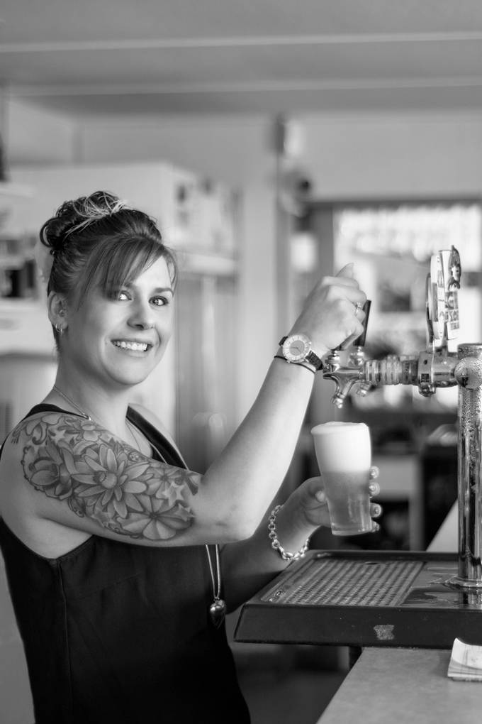 At the local pub in our small rural town. Our barmaid was very kind to let me photograph her at work.