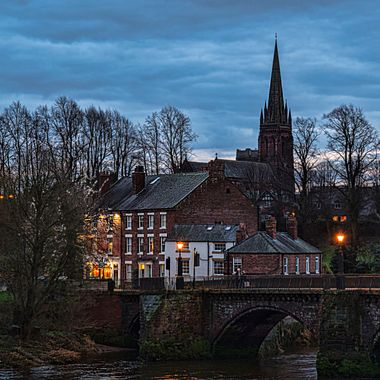 The Old Dee Bridge at Chester with a silhouette of St Mary's Church Handbridge.