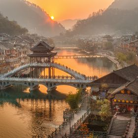 Sunrise over the Tuoliang River in the ancient town of Fenghuang in Hunan, China.