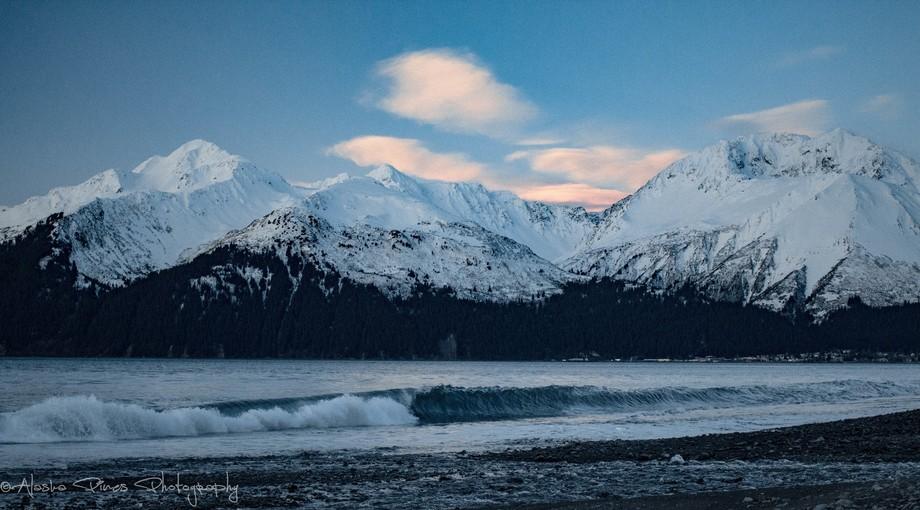 Watching the waves crash as the sun rises in Seward, Alaska.