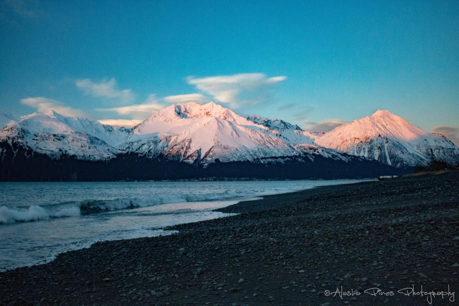 A quick shot of the pink mountains as the tide rolled in, along the beach in Seward, Alaska.