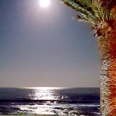 I took this photo when me and my wife were walking on the beach in the year 2016. There was a full moon that night and this was one of the photos I took that day.