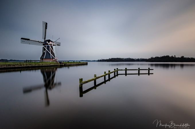 Windmill close a silent lake by mb_lichtbild - Windmills Photo Contest