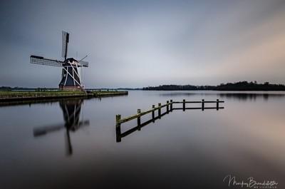Windmill close a silent lake