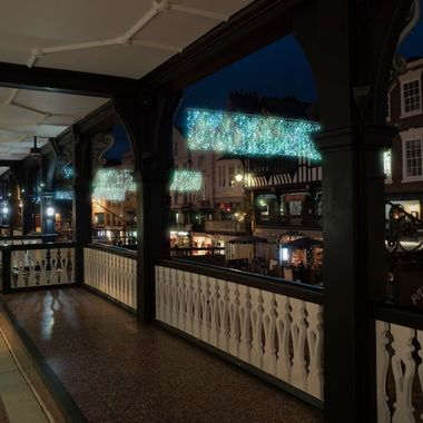 A view from the Bridge Street Row showing the festive lights over the street below.