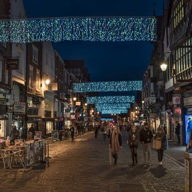Festive Lights over the streets of Chester during a late night shopping event.