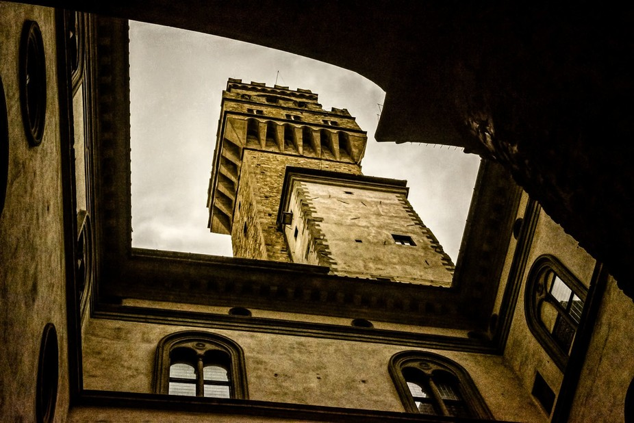 From a courtyard of the Palazzo Vecchio looking up to its famous tower, Florence, Italy