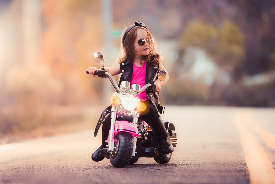 My adorable niece on her toy motorcycle. http://www.julieweissphotography.com