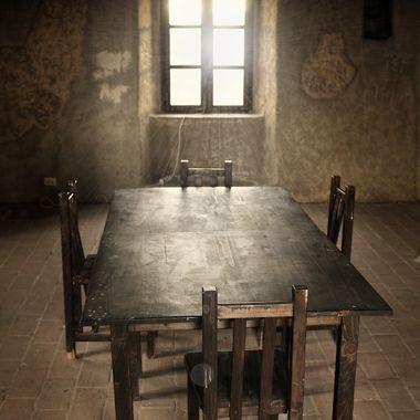 This was taken in Romania, near Brasov if I recall.  There are many castles and sites in Romania that have a lot of photo appeal. This particular table stood out, I liked how the window's light makes you look about the room after you have been drawn in.