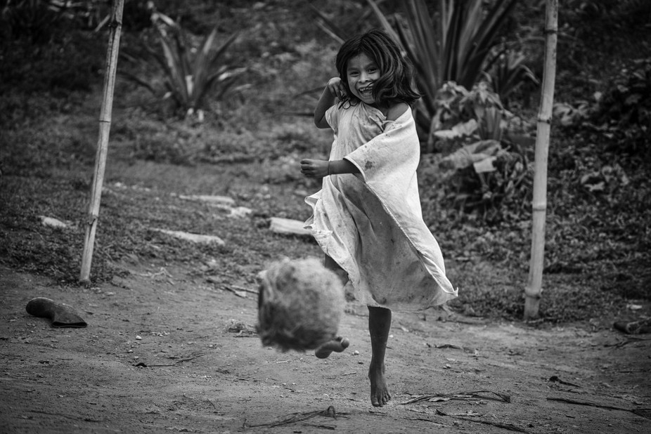 Wiwa indigenous playing football, Sierra Nevada de Santa Marta, Colombia
