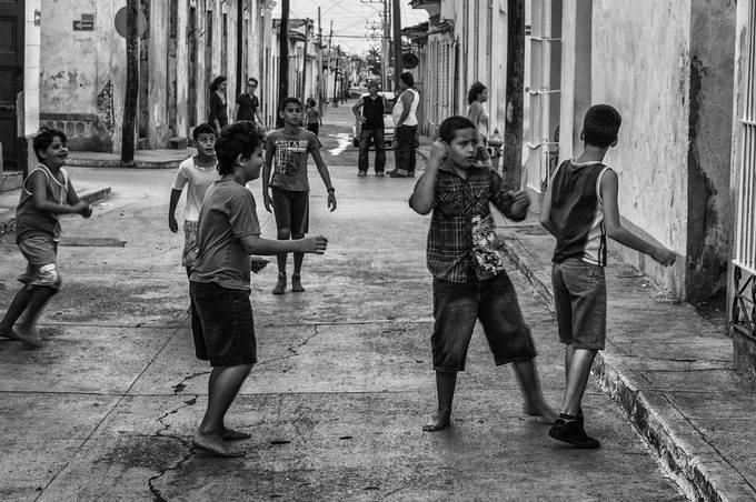 Trinidad - Cuba, boys were playing football, street photo