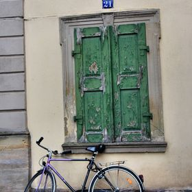 I loved the contrast of the aging shutters next to the new bike. I found this walking around Rothenburg, Germany.