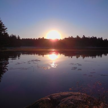 Calm Sept morning in Blind Bay one of my favorite spots on Rainy Lake to photo with a light fog Nikon Coolpix 6500