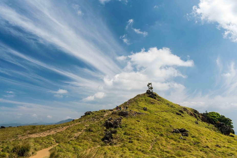 The view tower at Ponmudi in Kerala, India seems to touch the sky. The color of the sky and the c...